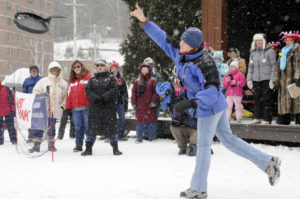 One of the participants in the Winter Carnival Ladies Fry Pan toss lets fly with her fry pan. Credit: Mark Kurtz, Saranac Lake Winter Carnival